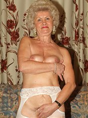 Naughty grannies Francesca and Erlene posing for the camera and stripping off their clothes