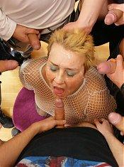 Kinky mature mama takes on seven guys