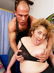 Big mama playing with her strapping toy boy