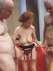 Redhead granny Linda lets her horny studs take turns in fucking her senior pussy live