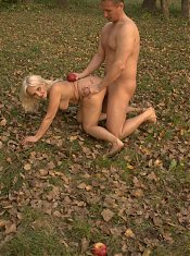 Blonde grandma Szandra goes down to suck a cock and got her pussy crammed with a dick in this outdoor porn