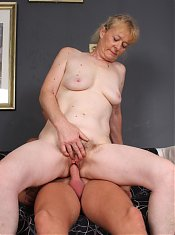 Maria is the pretty older lady enjoying a nice young cock during a webcam session