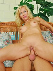 Experienced mature Melissa Q strips down and gives a younger guys dick a ride on webcam